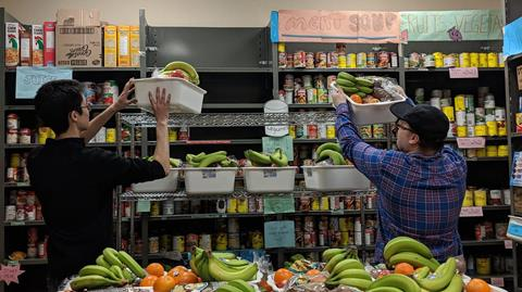 image of two men stocking food for the campus food bank