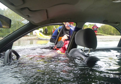 A car is submerged in water.