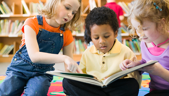 Image of children reading a book