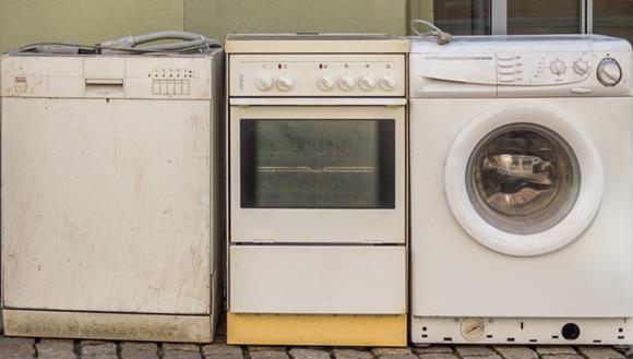 Old washing machine, oven and dishwasher