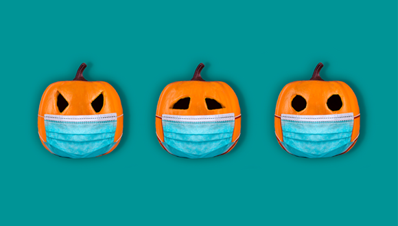 Carved pumpkins with masks covering their mouth