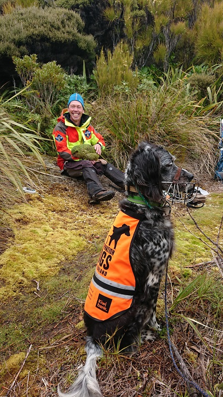 James Fraser holds kakapo Boss while Peg looks on - by Brodie Philp