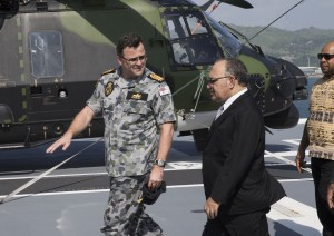 Commanding Officer HMAS Adelaide Captain Jonathan Earley talks with PNG Prime Minister Peter O'Neill. Defence