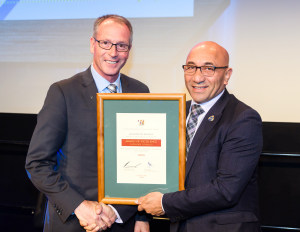 NIOA General Manager of Government Business Patrick Whitty (left) receives the award from NZ Minister of Defence, Ron Mark.