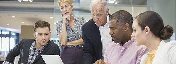 Interdisciplinary team working around a computer