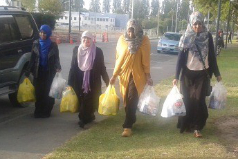 Image of ladies carrying shopping