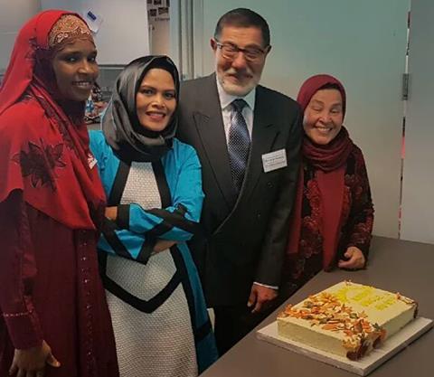 Ibrahim Abdelhalim (Centre) celebrating with parents/teachers.