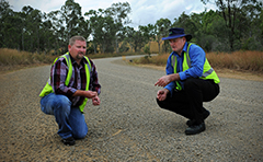 Councillor and Manager looking at rural road surface