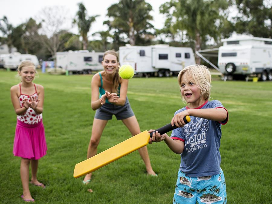 Family playing cricket on the New South Wales North Coast