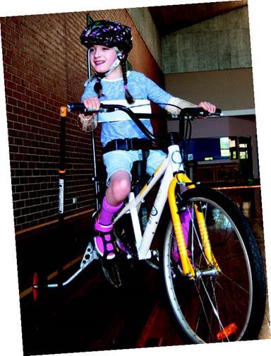 Girl riding a customised bike