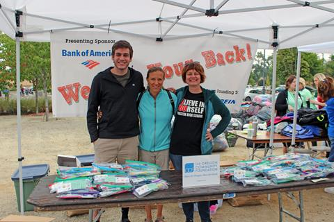OCF staff and volunteer at the We Got Your Back! event that provides school supplies for East Portland students.