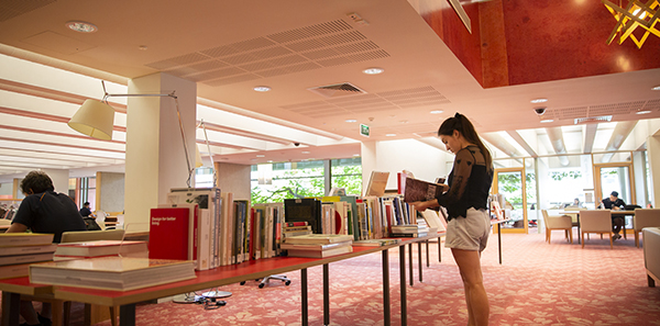 looking at design books at State Library