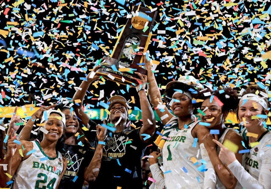 Baylor women's basketball team players celebrating after winning March Madness tournament