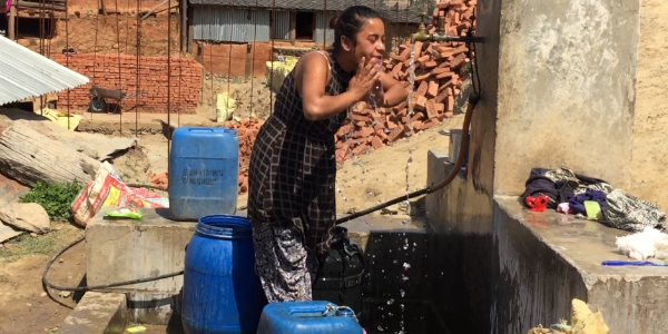 Woman washing her face in Nepal