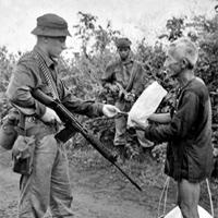 Brian Wilson (V Company) checks a Vietnamese civilian's identity card