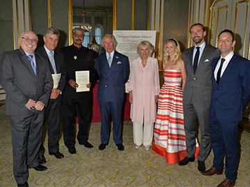 HRH Prince Charles (fourth from left) and Camilla, Duchess of Cornwall (fourth from right) with representatives of the five conservation organisations in the Asian Elephant Alliance. © Desmond O'Neill Features Ltd.