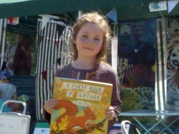 Iris Marshall, WLT competition prize winner at Camp Bestival.© WLT.