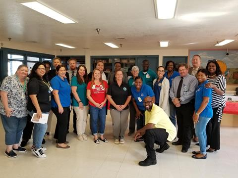Group photo of Clerk compliance staff and other attendees at the Sago Palm Job Fair
