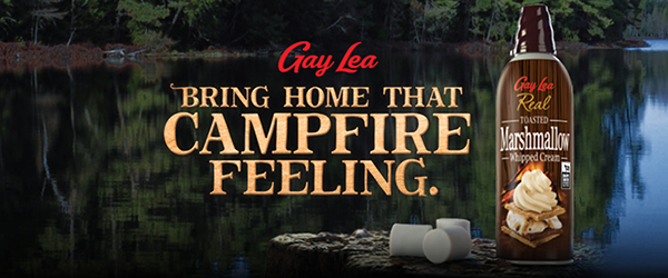Title – Gay Lea. Bring home that campfire feeling. Can of toasted marshmallow whipped cream with a lake background