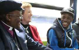 Mary Robinson and Desmond Tutu with a young person from XLP