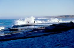 People fishing off rocks